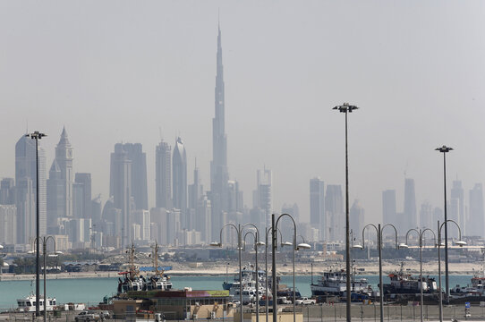 The skyline is seen with the Burj Khalifa as ships dock at Port Rashid, in Dubai
