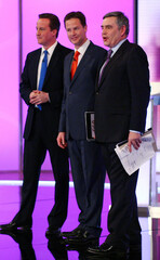 Britain's opposition Conservative Party leader Cameron, Liberal Democrat leader Clegg and PM Brown stand after a televised debate in Birmingham