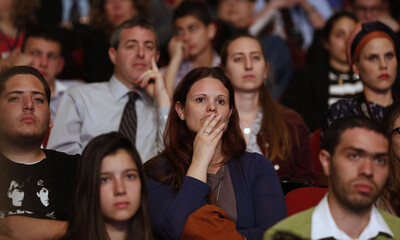 Students listen to U.S. President Obama talks at the Jerusalem Convention Center in Jerusalem