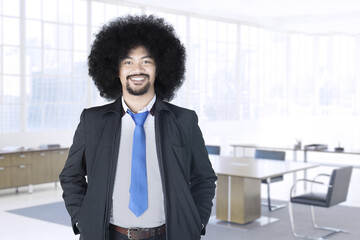 Afro businessman standing in office