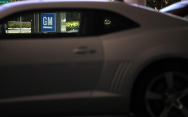 A GM sign is seen at a General Motors dealership in Miami