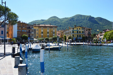 ISEO, ITALY - MAY 13, 2017: View of the pier of Iseo Lake with boats, Iseo, Italy
