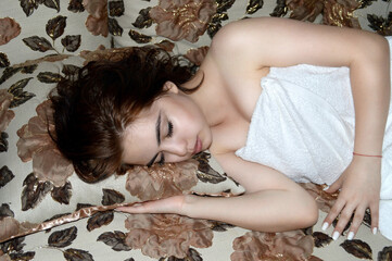 sleeping beautiful young girl/photography with scene beautiful young sleeping girl in bath towel on beautiful bed