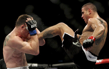 Sarafian of Brazil fights Dollaway of the U.S. during the Ultimate Fighting Championship in Sao Paulo