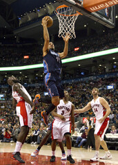 Toronto Raptors' Quincy Acy, Kyle Lowry and Aaron Gray give Charlotte Bobcats' Jeff Taylor a free pass to the basket in Toronto