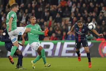 Paris St Germain's Lucas heads the ball to score past Saint-Etienne's Clerc and Monnet-Paquet, during their French Ligue 1 soccer match at the Parc des Princes stadium in Paris