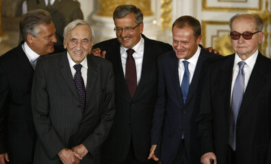 Newly sworn-in Polish President Komorowski smiles as he accepts congratulations from former president Kwasniewski, former PM Mazowiecki, PM Tusk and former president Jaruzelski after he received the presidential insignia at the Royal Castle in Warsaw