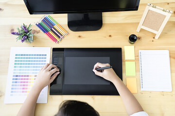 Graphic designer using graphics tablet and computer in the office