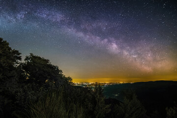 The Milky Way as seen from the summit of the hill Rahnfels in the Palatinate Forest near the city Bad Duerkheim in Germany.