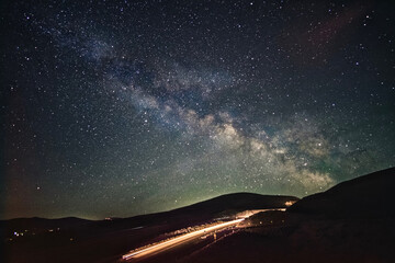 Highway to heavens. Milky Way over road. Portland. Oregon. The United States.