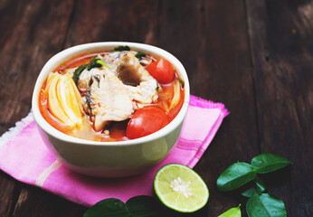 Tom yum soup with fish and spices hot spicy food