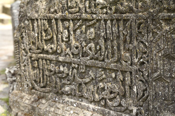 Arabian drawings and inscriptions are made on a very ancient stone