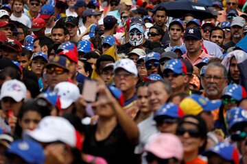 Oposition supporters rally against President Nicolas Maduro in Caracas