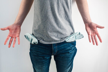 Moneyless Concept. Male Shows Empty Pockets