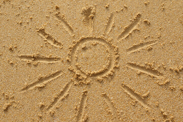 Drawing of sun on the sand