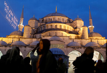 People walk past Ottoman-era Sultanahmet Mosque, also known as the Blue Mosque, on the first day of the fasting month of Ramadan in Istanbul