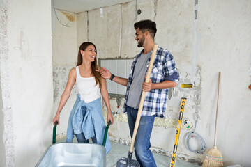 Beautiful young couple renovating their home