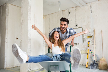 Loving couple is having fun while renovating their home