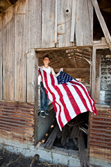 Boy hanging American flag