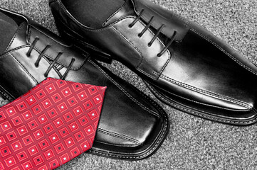 Black leather dress shoes and necktie