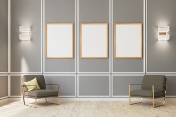 Three framed posters on gray wall, armchairs