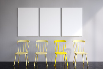 Three posters and yellow chairs Wall mural