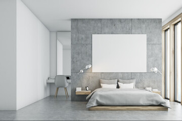 Gray bedroom with poster and study