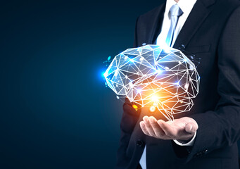 Businessman s hand holding holographic brain