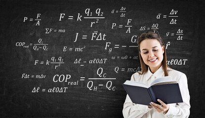 Cheerful woman with book and formulas