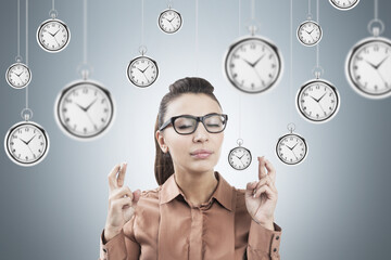 Woman with crossed fingers and clocks
