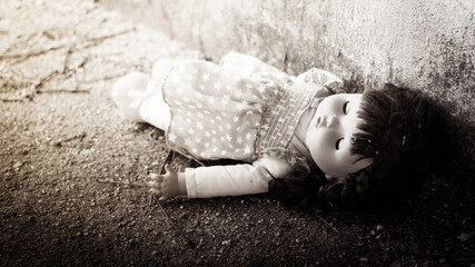 Andoned Person,Abandoned doll laying on Dirty floor,black and white tone