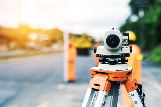Surveyor's telescope at new road construction site