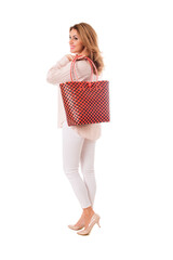 Pretty woman posing with bright wicker red tote bag.Isolated on the white studio background