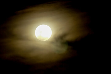 Full moon on dark sky with mist