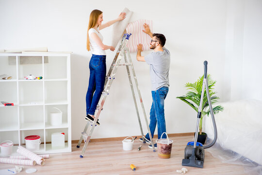 Couple renovating apartment