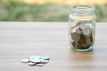 Money coin saving in glass jar, finance saving concept