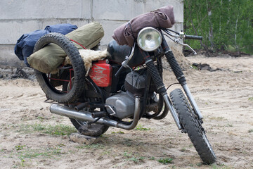 A post apocalyptic motorcycle near the destroyed building