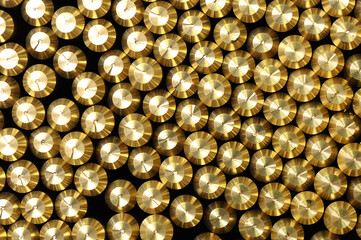Background pattern of bevelled brass rods