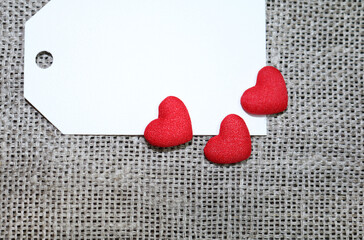 Red textured hearts on unpainted canvas