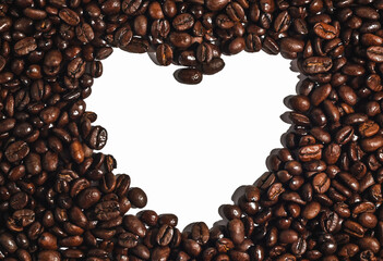 A surface of coffee beans with a free space in the form of a heart