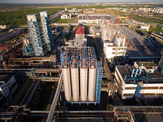 A huge oil refinery with pipes and distillation of the complex. Aerial view