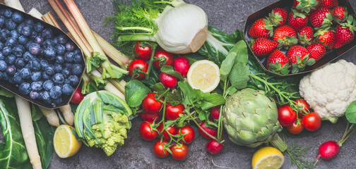 Various organic vegetables, fruits and berries for healthy, clean , vegetarian or diet eating, top view, banner