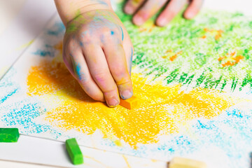 Baby draws the crayons.Selective focus. Children's Creativity. Early child development