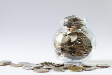 Coin in glass bowel ,saving money concept