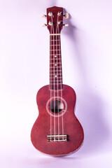 old ukulele on white background