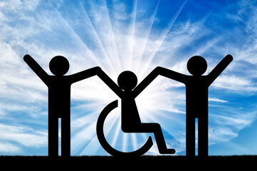 Happy disabled person in a wheelchair together with healthy people