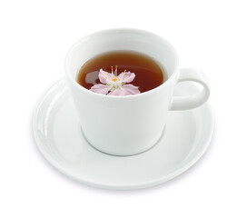 Tea in a cup with cherry flower