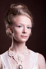 Gorgeous beautiful blonde woman in vintage victorian dress. Rich and vintage. Luxury and elegance. Studio photo