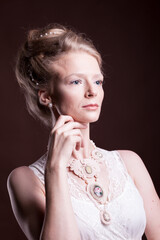 Portrait of  beautiful blonde woman in vintage victorian dress. Rich and vintage. Luxury and elegance. Studio photo