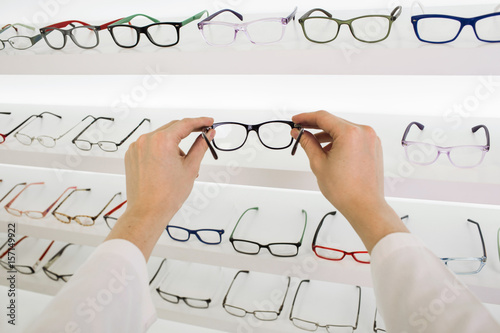 031cebf5b20 Ophthalmologist holding glasses for correction of vision
